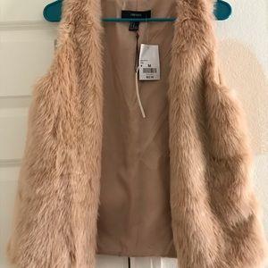 Pink faux fur vest. Brand new